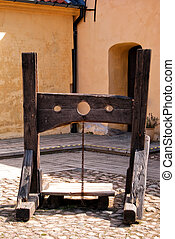 torture stocks - A medieval torture device situated on the...