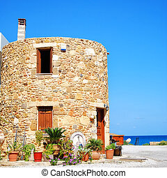 Greek round house - A round shaped house situated on the...
