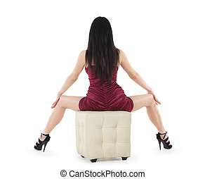 backview of sitting sexy woman in red dress on the chair