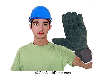 Young tradesman wearing an oversized glove