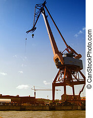 shipping industry dock - Large industrial shipping crane at...