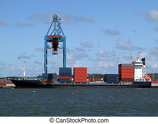 Cargo shipping industry - a huge container cargo ship being...