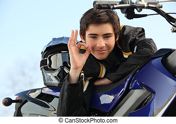 Boy with a motorbike