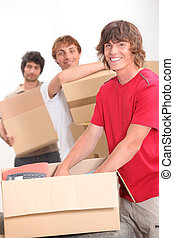 trio of flat mates moving in together