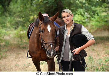 Blond teenager with horse