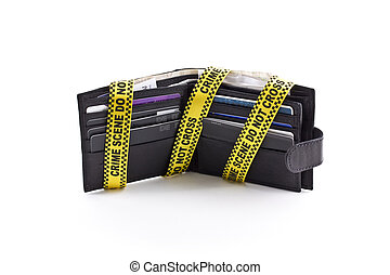 Wallet open with crime scene tape