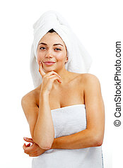 Portrait of young beautiful woman after bath. Isolated over...