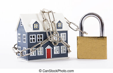 House secured with padlock - House secured with chain and...