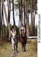 twosome of horse riders