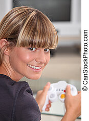 Young woman playing a video game