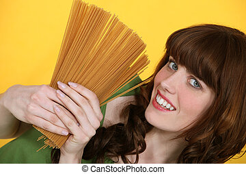 A woman about to cook pastas.