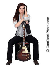 Attractive brunette with electric guitar