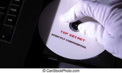 Top secret disc, strictly confidential, closeup DVD in and...