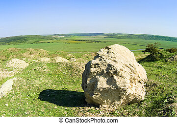 Rural landscape with big stone
