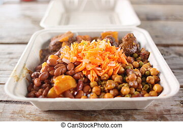 Delicious curry entree in a takeout container