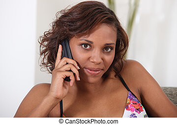 Pretty Metis woman on phone at home