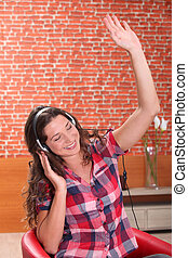 young woman listening and enjoying music