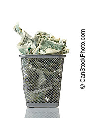 Money in basket Isolated over white