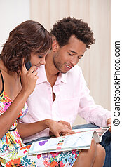 young couple ordering by phone