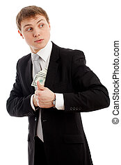 Man in a putting money in his pocket Isolated over white