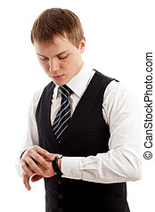 Young man checking time. Isolated over white.