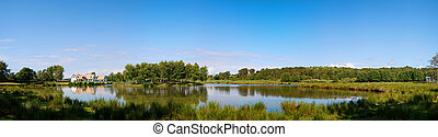 Lakehouse panorama - A panoramic view of a countryside lake...