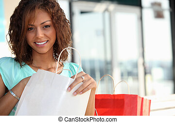 coloured girl enjoying shopping