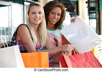 Two beautiful girls shopping