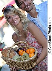 Couple buying fruit