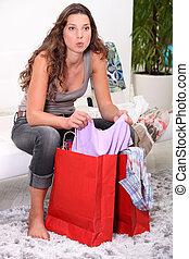 A brunette going through her shopping.