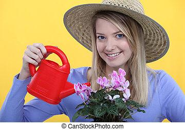 Woman watering her flowers.