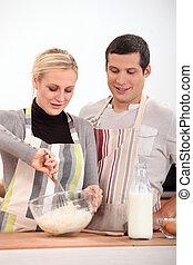 A couple baking
