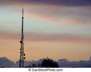Communications mast 03 - Communications mast silhouetted...