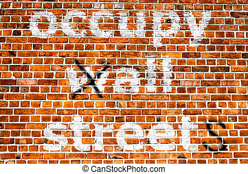 occupy all streets - An image of a political message painted...