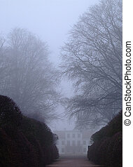 Misty mansion - spooky looking mansion shrouded in mist