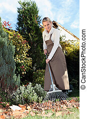 woman gardening with rake