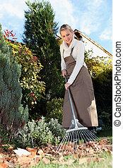 woman gardening with rake