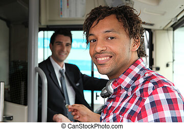 Man paying for bus ticket