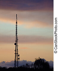 Communications mast 01 - Communications mast silhouetted...