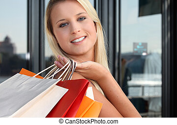 a blonde woman doing shopping