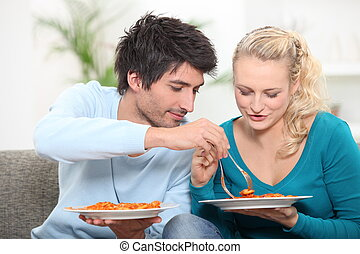 young couple having dinner at home