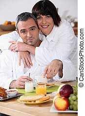 Couple at breakfast in bathrobes