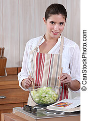 Woman tossing a salad