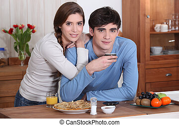 A young couple having breakfast.