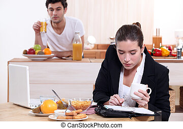 young active couple having breakfast
