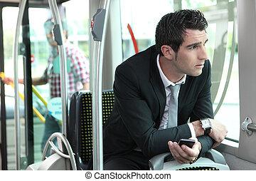 Man riding tram to work