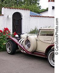 Vintage motor car - old vintage motor car parked outside a...