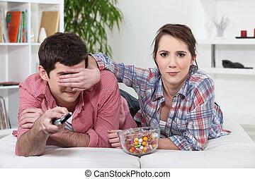 Woman blocking her boyfriend's line of vision