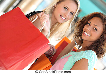 girls in shopping frenzy