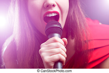 Singer - Woman sing over color background Focused on arm